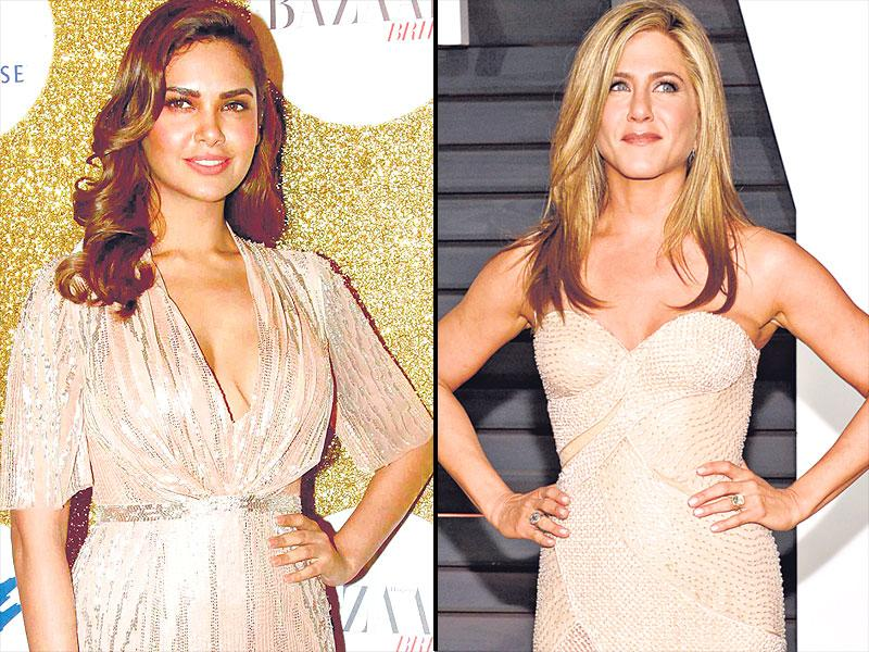 A liquid-gleam Jenny Packham dress on actor Esha Gupta (R) looks amazing while Jennifer Aniston's (L) Versace fits her like a second skin.