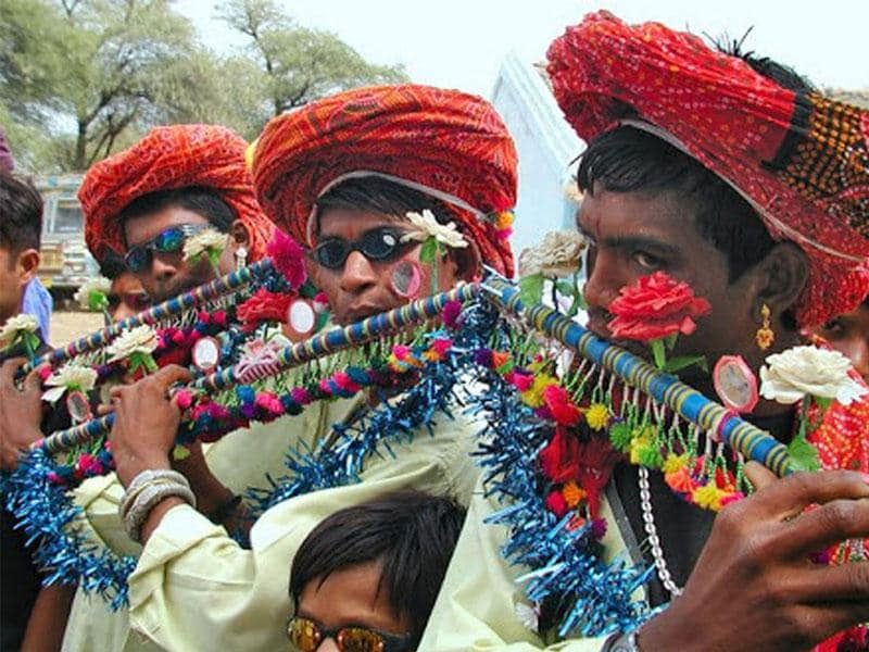 Tribal youths celebrate as the week-long traditional Bhagoria festival kicked-off in Khargone district on Friday. (HT photo)