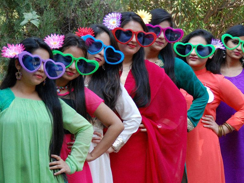 Girls participate in fancy dress competition at Nutan College in Bhopal on Thursday. (PTI photo)