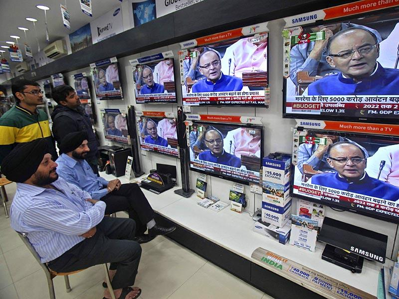 People watch Arun Jaitley presenting the budget in Chandigarh. (Reuters)