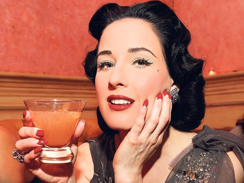Go old school à la burlesque diva Dita Von Teese by styling a reverse French manicure in a bold hue on stiletto (pointed) nails.