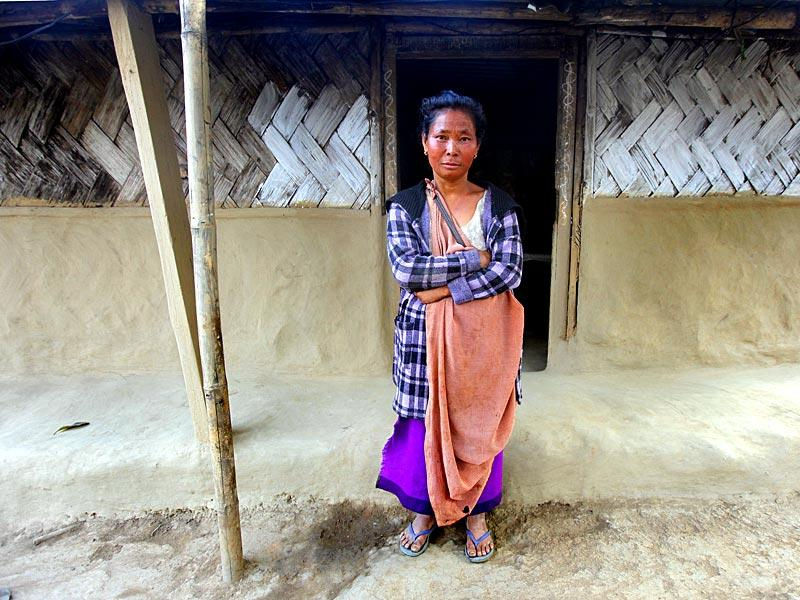 Ibina Sohbar alone supports her family of 20 from the money she earns from the coal mines and a patch of land which is rented out to other coal miners to stock their extracted coal. (Arun Sharma/ HT Photo)