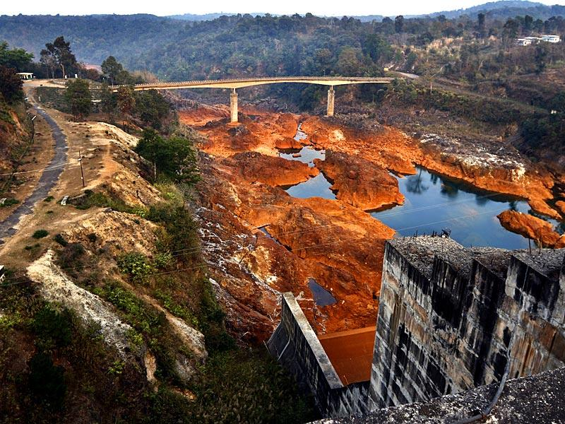 Hydroelectric dam on River Kupli that forms the border between Assam and Meghalaya. The acidic content in the water corrodes the under water parts of the hydroelectric dam. (Arun Sharma/HT Photo)