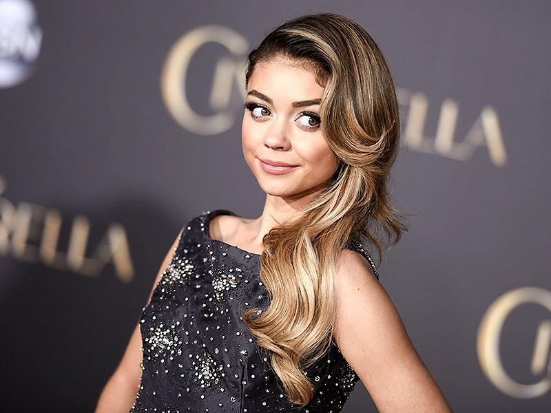 Sarah Hyland arrives at the premiere of Cinderella in Los Angeles. (AP)
