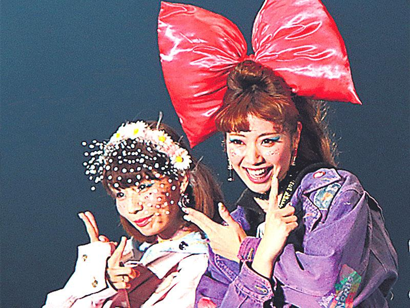 Models in quirky headgears for Tokyo Girls collection in Tokyo, Japan.