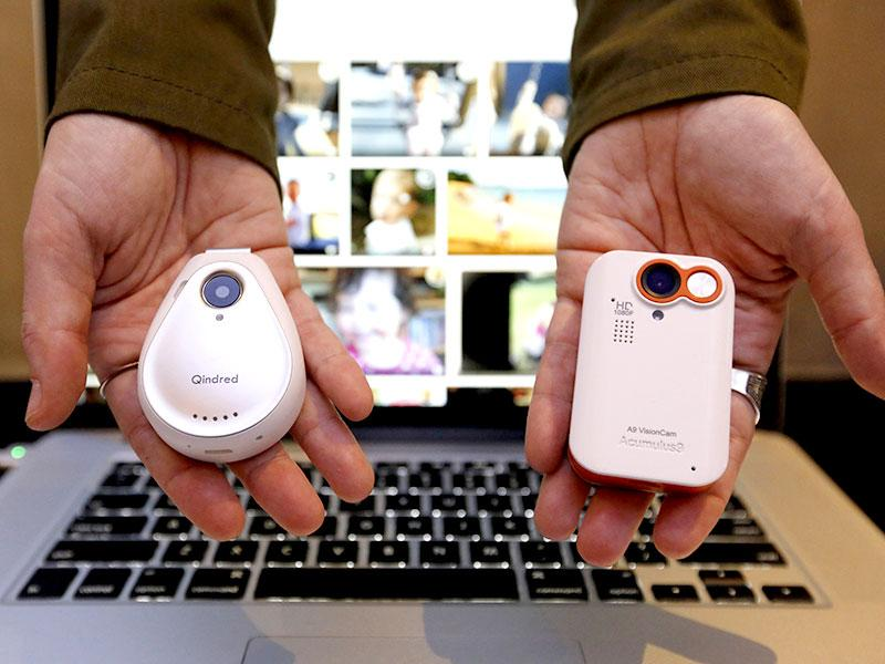 A prototype of Acumulus9's wearable camera QuidredCam (L) is shown during the Mobile World Congress in Barcelona. Photo: Reuters