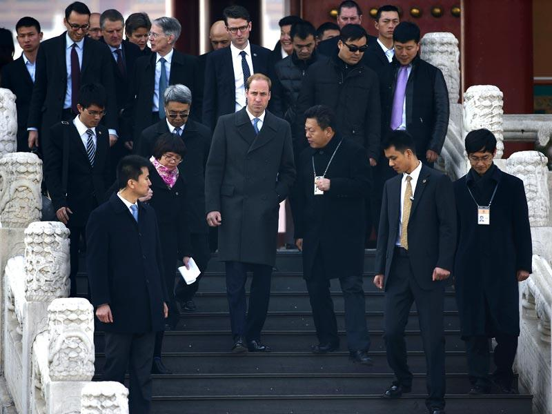 Britain's Prince William accompanied by British and Chinese delegations, visits the Forbidden City in Beijing.(AP Photo)