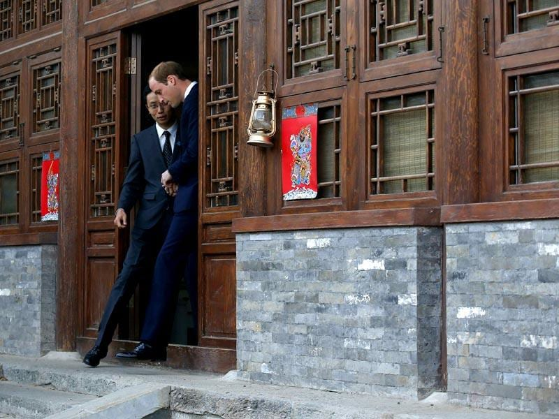 Britain's Prince William is guided by Matthew Hu, China's representative of the Prince's School of Traditional Arts while he visits the Shijia Hutong in Beijing . (Reuters Photo)