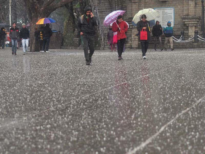 People walking at Ridge during hailstorm in Shimla. Santosh Rawat/HT