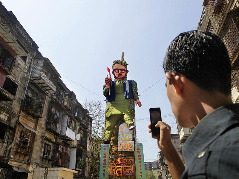 A 55-feet-effigy of the terrorist who attacked a school in Peshawar, Pakistan was erected to be burnt as part of Holi festivities at Worli, Mumbai. (Kalpak Pathak/HT photo)