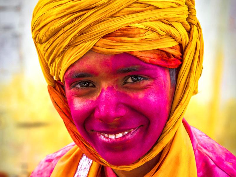 A young boy smeared with colour in Barsana. (Abhishek Saha/HT Photo)