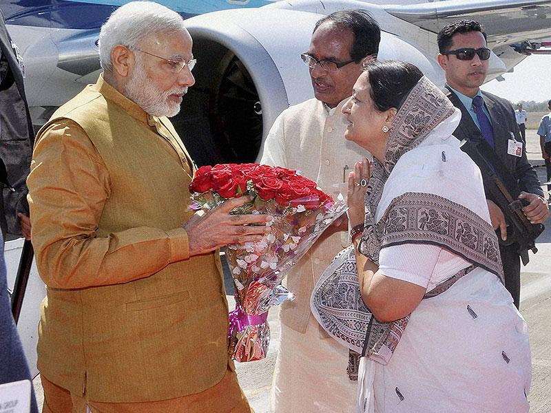 MP chief minister Shivraj Singh Chouhan and Indore mayor Malini Gaud welcome Prime Minister Narendra Modi on his arrival in Indore on Thursday. (PTI photo)