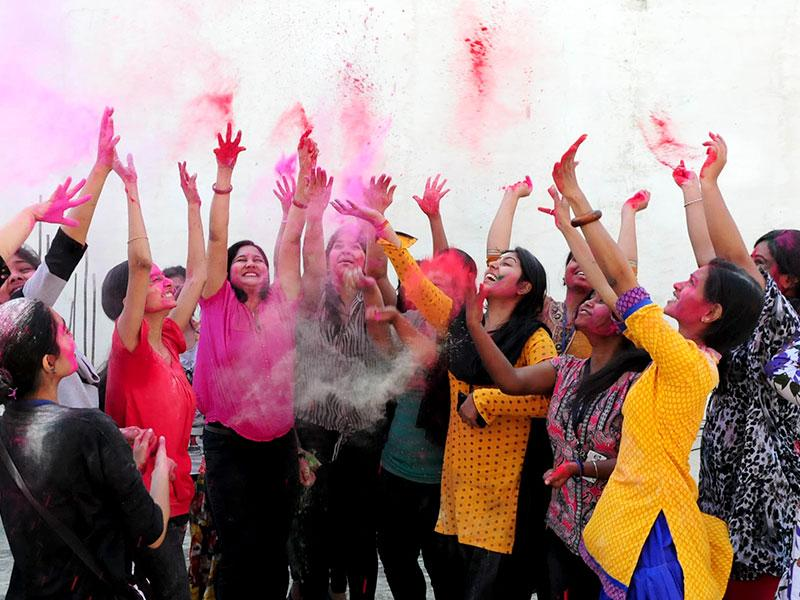 Students of Indian Institute of Fashion Technology celebrate Holi with vibrant colors in Bhopal on Thursday. (Mujeeb Faruqui/HT photo)