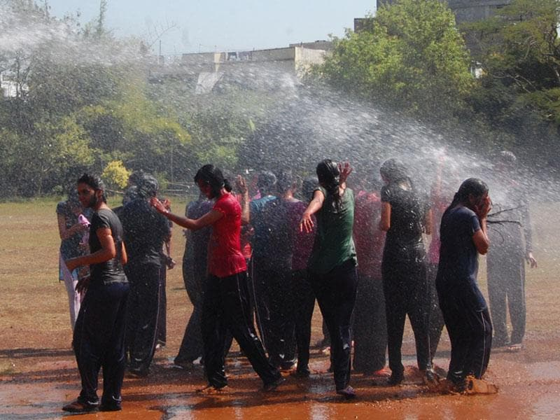 Women police personnel celebrate Holi in Bhopal on Saturday, a day after the festival. (Bidesh Manna/HT photo)
