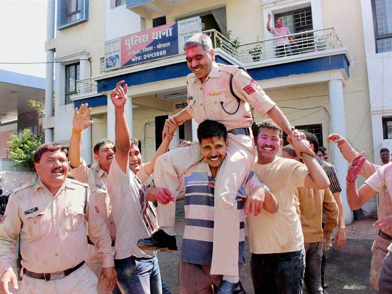 Madhya Pradesh police personnel celebrate Holi with zeal in Bhopal on Saturday, a day after the festival. (PTI photo)