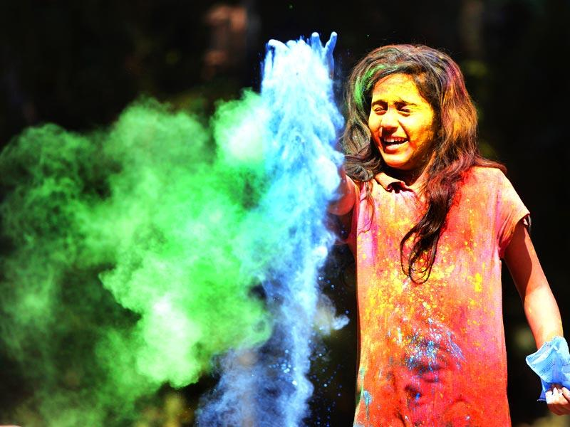 A young kid plays Holi, the festival of colours, Holi at Dadar in Mumbai. (Kalpak Pathak / Hindustan Times)