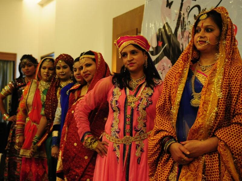 Women dress up to take part in a fashion show organised on the occasion of Women's Day in Bhopal. (Mujeeb Faruqui/HT photo)