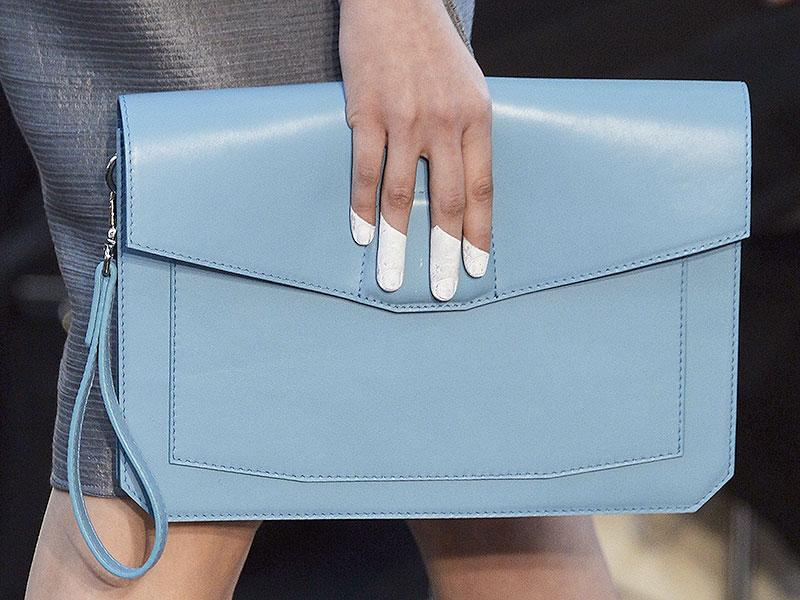 Christine Phung: A contemporary inversion of the fingerless glove was on show at Christine Phung, where models' fingertips were painted in pastel shades to match the clutch bags they were carrying.