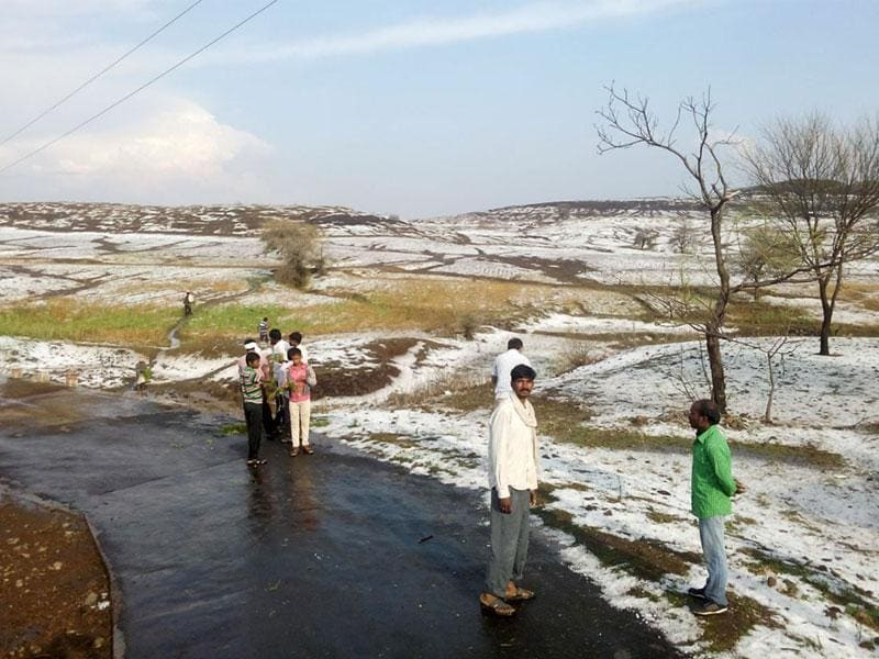 Hail stones cover roads and agriculture fields in Betul district of Madhya Pradesh on Monday. Nearly half-a-dozen villages were affected by hail storm. (HT photo)