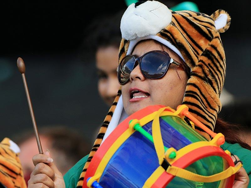 A supporter of the Bangladesh team plays a drum during their Cricket World Cup Pool A match against England in Adelaide. (AP Photo)