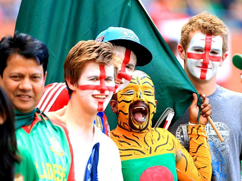 England and Bangladesh supporters pose for a photo during the Cricket World Cup Pool A match in Adelaide. (AP Photo)