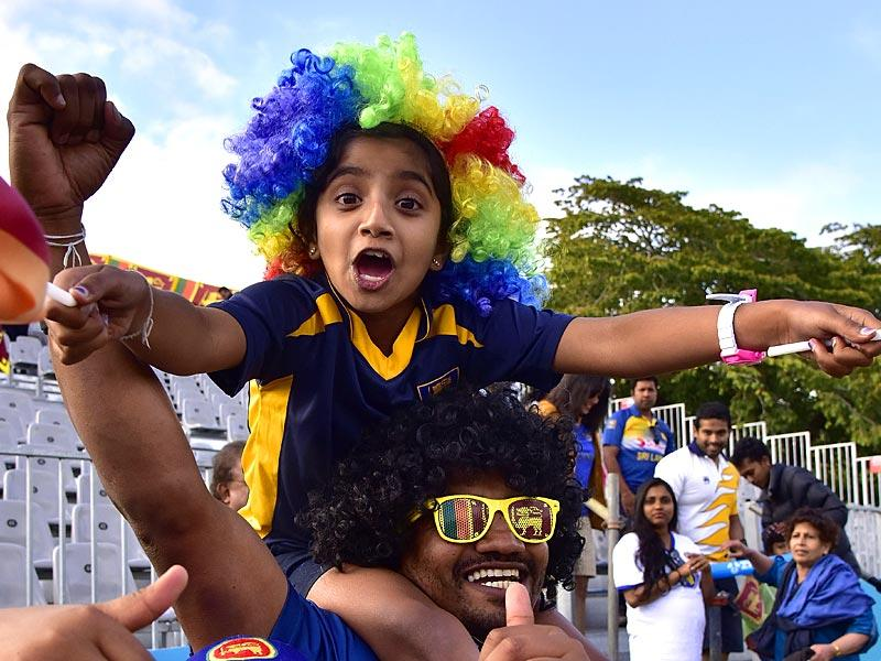 Sri Lankan fans celebrate their win after the Pool A 2015 Cricket World Cup cricket match between Sri Lanka and Afghanistan at University Oval in Dunedin. (AFP Photo)
