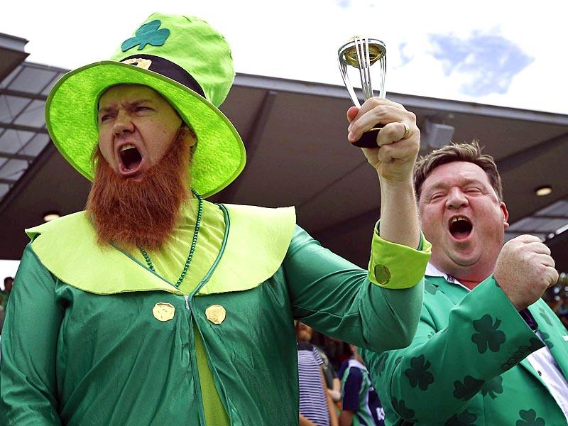 An Ireland supporter in costume holds a replica World Cup trophy as he sings the national anthem with a fellow supporter before the start of the 2015 World Cup match between Ireland and South Africa at Manuka Oval in Canberra on March 3. (Reuters Photo)