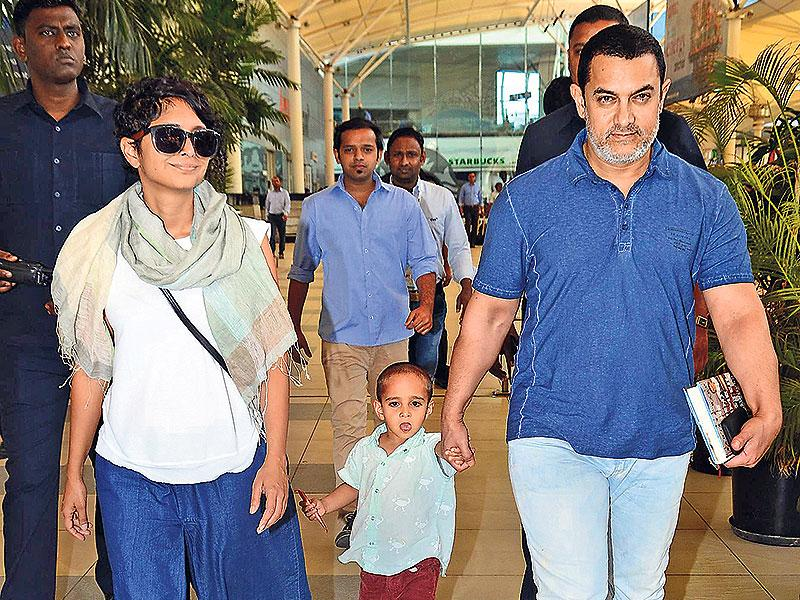 Mr Perfectionist Aamir Khan celebrates his 50th birthday on Saturday. The man, who has half the country raving about his acting prowess and his concern for social issues, is also a dedicated family man. Be it a movie screening or random promotional events or parties, he is mostly spotted alongwith wife Kiran Rao and kids. Browse for pics:Surrounded by bodyguards, Kiran Rao and Aamir Khan, along with son Azad, walk out of the Mumbai airport. (Photo: Viral Bhayani)