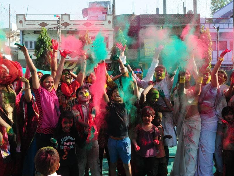 People celebrate Rang Pancahmi with zeal at Naveen Nagar in Bhopal on Tuesday. (Mujeeb Faruqui/HT photo)