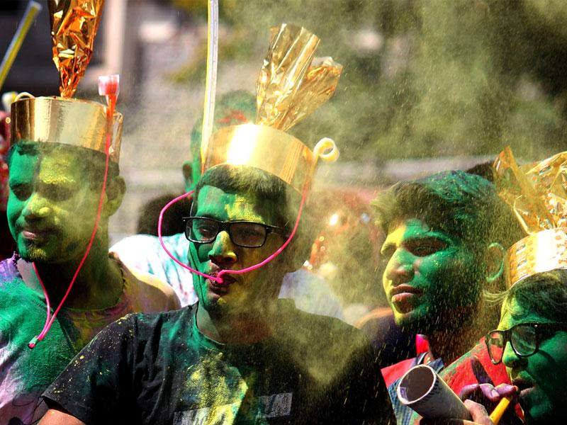 A group of boys in Indore celebrates Rang Panchami with fervour on Tuesday. (Shankar Mourya/HT photo)