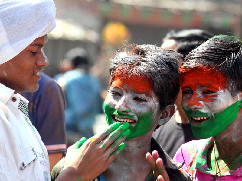 Children smear their faces with colours of the Indian flag on the occasion of Rang Panchami, in Indore on Tuesday. (Shankar Mourya/HT photo)
