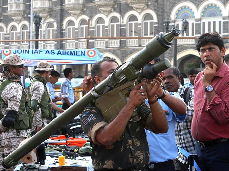 An Indian Air Force commando rehearses on the eve of the celebration of the 50th year of 1965 Air Campaign at Gateway of India, in Mumbai. (Arijit Sen/HT photo)