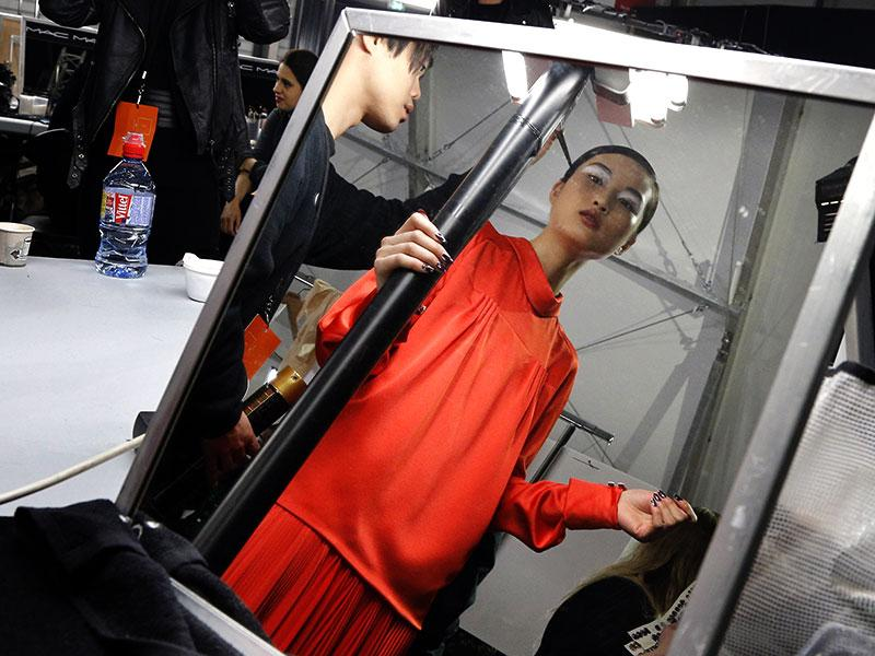 Kenzo: A model checks herself over before walking out for Kenzo.
