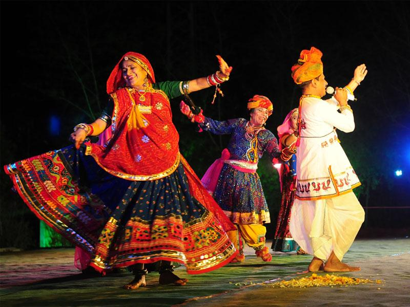 Members of Kesaria Balam group from Indore perform during 'Faag Utsav' organised in Bhopal on Tuesday. (Mujeeb Faruqui/HT photo)
