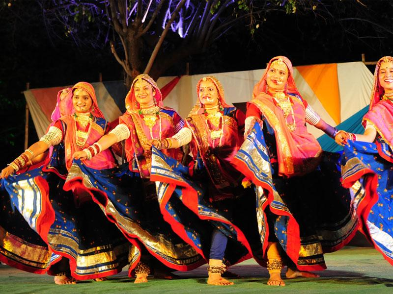 Dancers belonging to Indore's Kesaria Balam group perform during 'Faag Utsav' organised at IGRMS in Bhopal on Tuesday. (Mujeeb faruqui/HT photo)