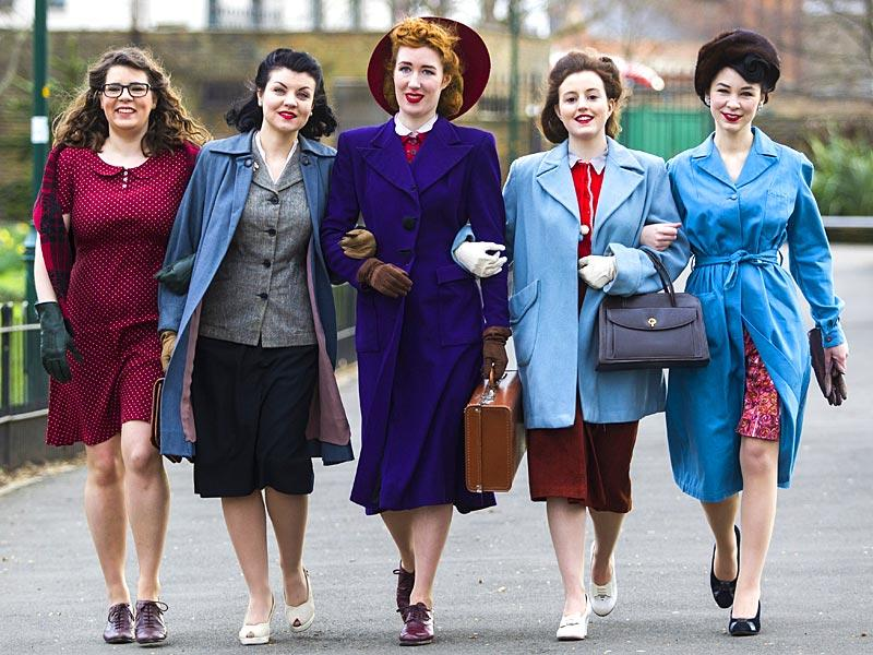 London: Models dressed in 1940s-style clothing pose during a photo call for the exhibition 'Fashion on the Ration - 1940s Street Style' outside the Imperial War Museum (IWM) in London on March 3, 2015. The exhibition, which explores how fashion survived and even flourished under the strict rules of rationing during World War II, will be open to the public from March 5 to August 31, 2015.