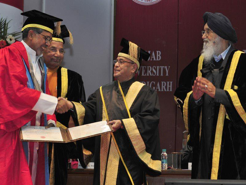 Nobel Peace Prize Laureate Kailash Satyarthi receiving the honorary degrees from President of India Pranab Mukherjee during the Sixty Fourth Convocation of Panjab University in Chandigarh on Saturday. Gurpreet Singh/HT