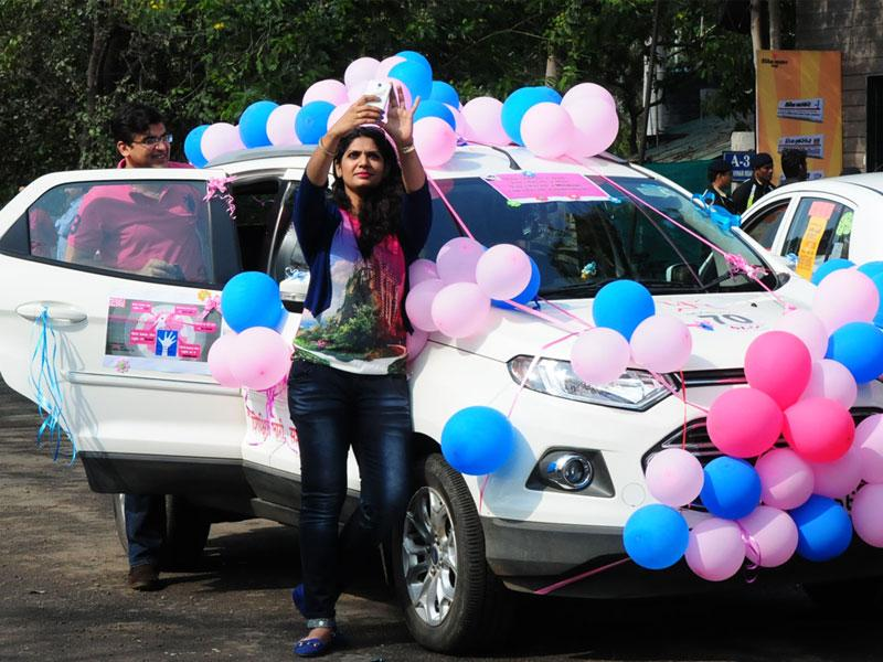 A woman takes a selfie with her car before taking part in a women's car rally in Bhopal on Sunday. (Mujeeb Faruqui/HT photo)