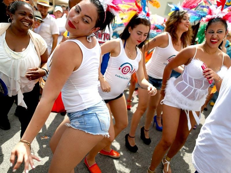 People dance at the Calle Ocho festival in the Little Havana neighborhood in Miami, Florida. AFP Photo