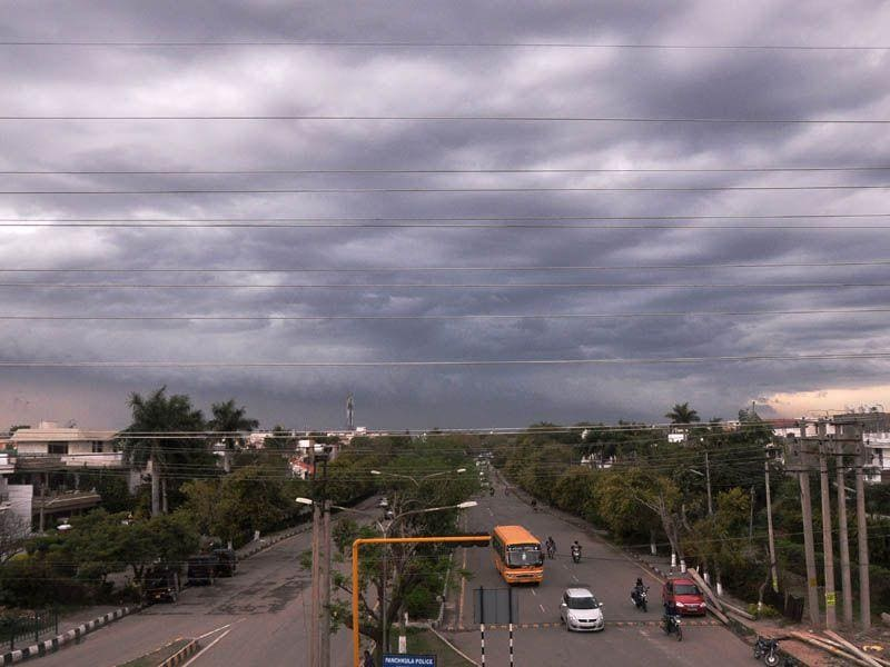 Black clouds hovering in Panchkula on Monday. Sant Arora/HT