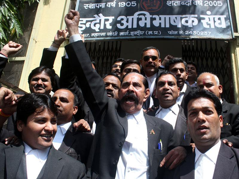 Members of Indore District Bar Association stage a protest against the killing of an advocate in Allahabad, in Indore on Monday. (Shankar Mourya/HT photo)