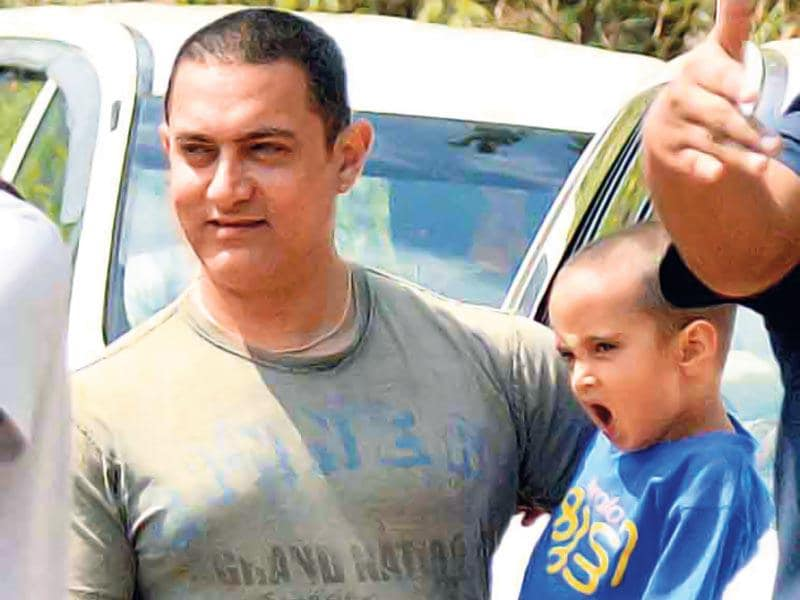 Aamir Khan celebrated his 50th birthday with a bash planned by his wife, Kiran Rao, at their Lonavala house. He is seen with his son Azaad. (Photo: Yogen Shah)