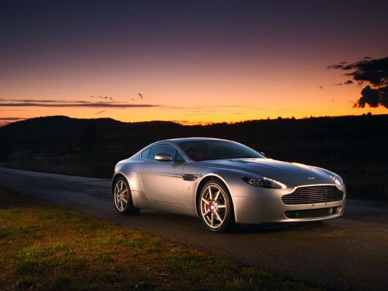 The Aston Martin V8 Vantage 2004 : Proving that good things come in small packages, Fisker followed up the DB9 with the smaller, two-seat V8 Vantage, which bears a huge family resemblance but is still different enough to make its own visual statement. After completing the design, Fisker left Aston to start his own car company. Photo:AFP