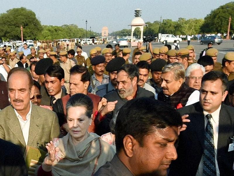 Congress president Sonia Gandhi with senior party leaders Ghulam Nabi Azad and Anand Sharma during their march from Parliament to Rashtrapati Bhavan in New Delhi. (PTI photo)