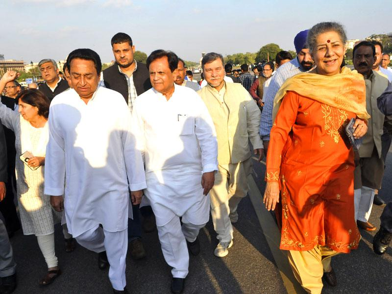 Congress leader Kamal Nath, Ahmed Patel, Ambika Soni, and Renuka Chowdhury with TMC MPs take part in a march to Rashtrapati Bhawan against the land bill, in New Delhi. (Photo by Vipin Kumar/ Hindustan Times)