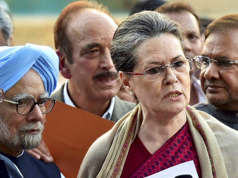 Congress president Sonia Gandhi, accompanied by former PM Manmohan Singh and a delegation of Opposition parties' leaders, addresses the media after meeting President Pranab Mukherjee over the controversial Land Acquisition Bill, at Rashtrapati Bhavan in New Delhi. (PTI photo)