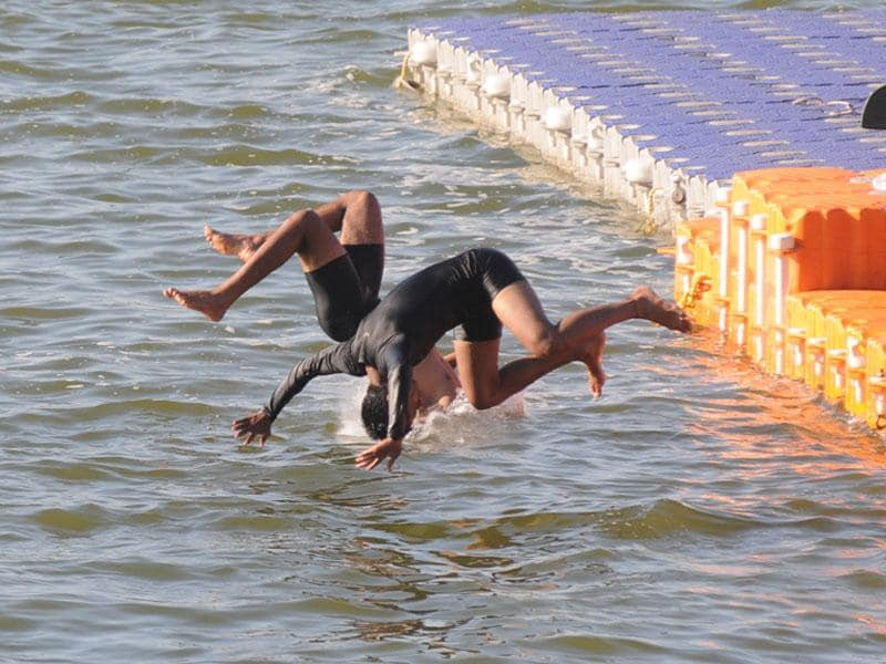 Students of water sports department jump into Upper Lake during their practice session at the Boat Club in Bhopal on Wednesday. (Bidesh Manna/HT photo)