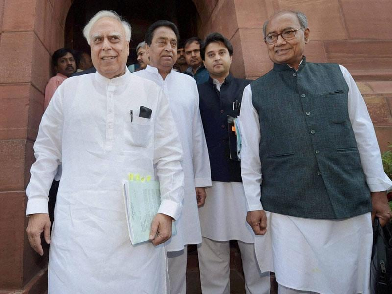 Kapil Sibal, Kamalnath, Jyotiraditya Scindia and Digvijaya Singh after meeting the PM on the issue of PEB scam, in New Delhi on Wednesday. (PTI photo)