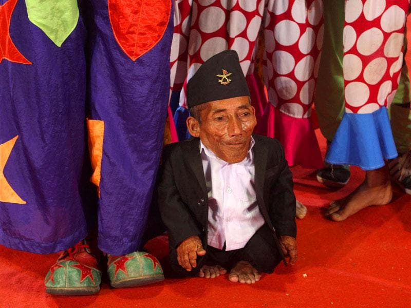 World's shortest man Chandra Bahadur Dangi interacted with the artists of Rambo Circus in Mumbai. This was his first visit to India. (Arijit Sen/HT photo)