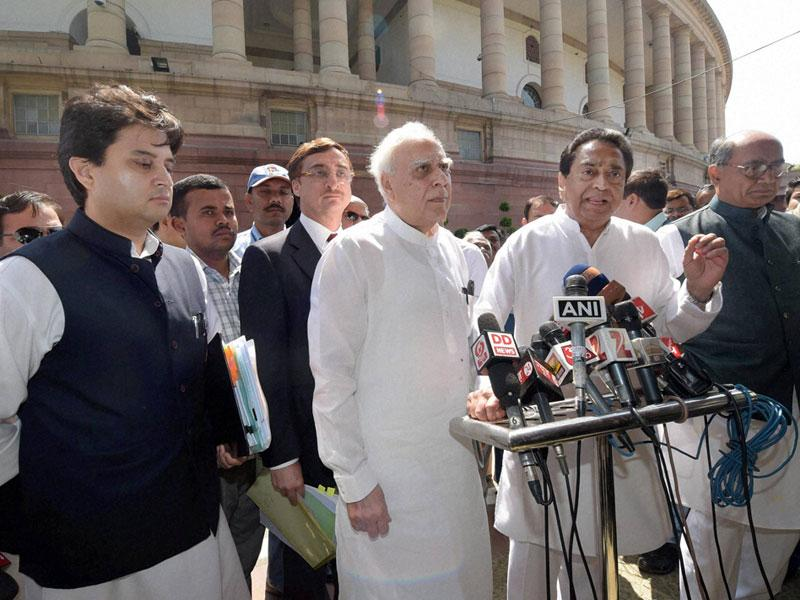 Jyotiraditya Scindia, Kapil Sibal, Kamalnath and Digvijaya Singh talk to the media after meeting the PM on the issue of PEB scam. (PTI photo)